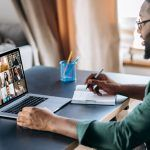 Online business briefing. Male African American employee speak on video call with diverse multiracial colleagues, on laptop screen diverse business people, meeting online, group brainstorm, remote work